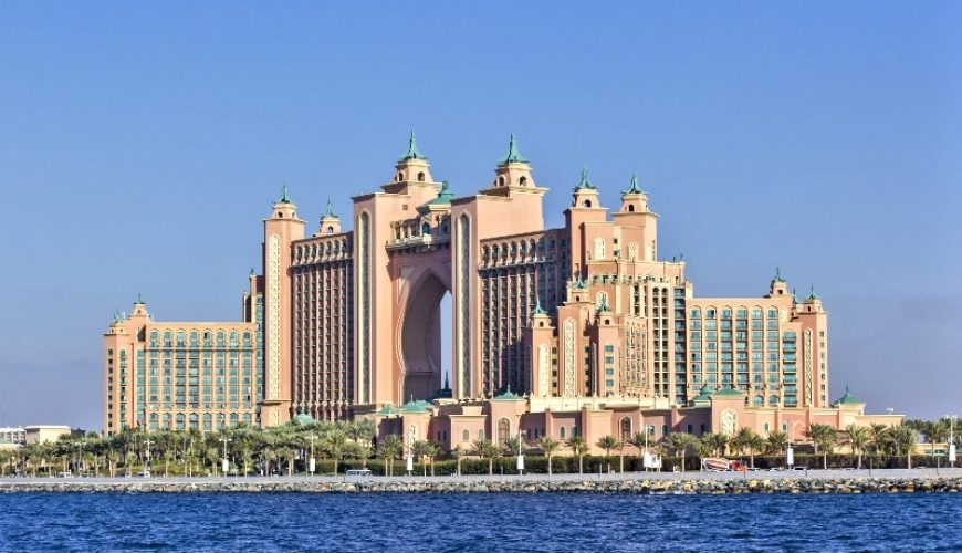 Visit Dubai_Background view from the water of the building the Atlantis Hotel at the top of the Palm in Dubai