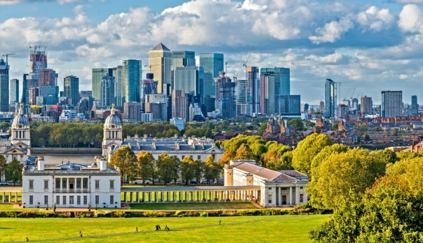 Taste of London_England, Panoramic Skyline View Of Greenwich College and Canary Wharf At Golden Hour Sunset With Blue Sky And Clouds