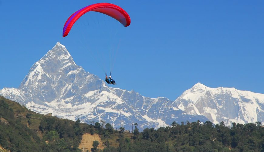Paragliding in Nepal with view on Fishtail Mountain of the Himalaya at Pokhara